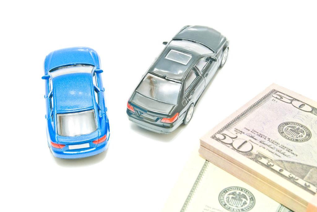 Black and blue cars near bills