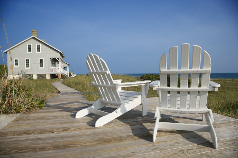 Chairs on deck overlooking beach