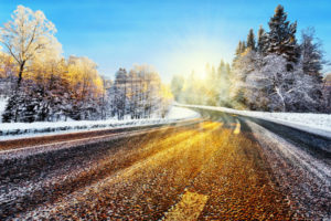 Winter road in sunlight