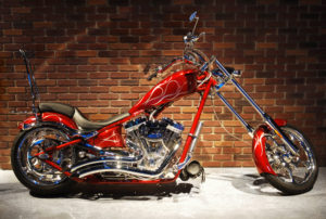 Red Chopper on brick wall