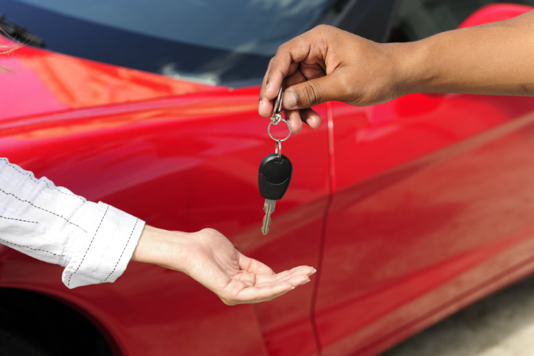 Woman receiving car key