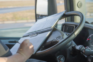 Truck Driver Filling Out Paperwork